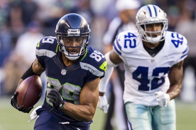 Seattle Seahawks wide receiver Doug Baldwin (89) outruns Dallas Cowboys strong safety Barry Church (42) for a 27-yard gain at CenturyLink Field in Seattle, Washington on August 25, 2016. The Seahawks beat the Cowboys 27-17. Photo by Jim Bryant/UPI