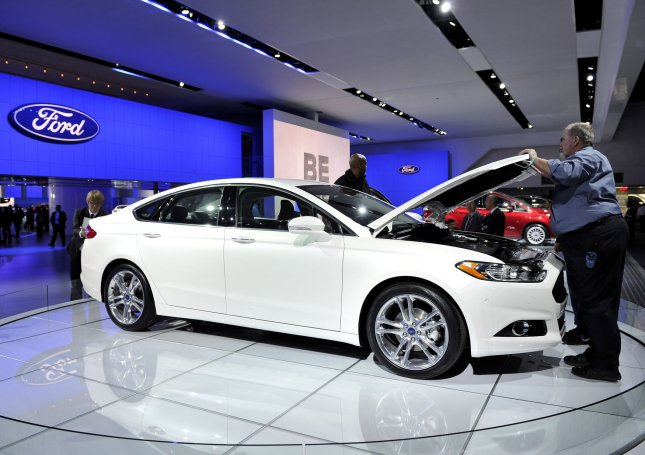 The Ford Fusion is displayed at the North American International Auto Show in Detroit, Mich. The Ford Motor Company announced a recall of Fusion, Modeo and Lincoln MKZ models to repair a seat belt defect. Two accidents have been attributed to the defect. File photo by Brian Kersey/UPI