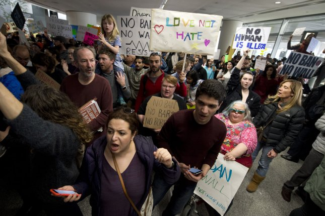Demonstrators jam the international arrivals area at San Francisco International Airport on Sunday in opposition to a President Donald Trump's travel ban affecting some countries with mostly Muslim populations and his executive orders directing the construction of a wall along the border with Mexico. On Tuesday, the city of San Francisco began a separate act of defiance by filing a lawsuit on Trump over his executive order related to sanctuary cities, which threatened a funding cut-off. Photo by Terry Schmitt/UPI