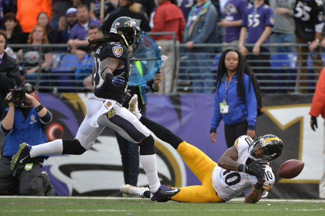 Baltimore Ravens free safety Kendrick Lewis (23) breaks up a pass intended for Pittsburgh Steelers wide receiver Martavis Bryant (10) in the fourth quarter at M&T Bank Stadium in Baltimore, Maryland on December 27, 2015. The Ravens defeated the Steelers 20-17. Photo by Kevin Dietsch/UPI