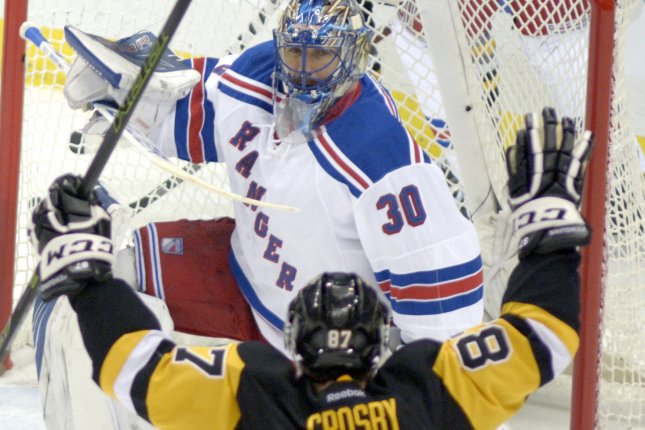 New York Rangers goalie Henrik Lundqvist (30) reacts as Pittsburgh Penguins center Sidney Crosby (87) celebrates. File photo by Archie Carpenter/UPI