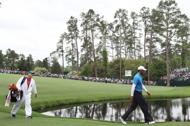Tiger Woods walks to the No. 15 green during the 3rd round of the 2018 Masters Tournament Saturday at the Augusta National Golf Club in Augusta, Ga. Photo by John Angelillo/UPI