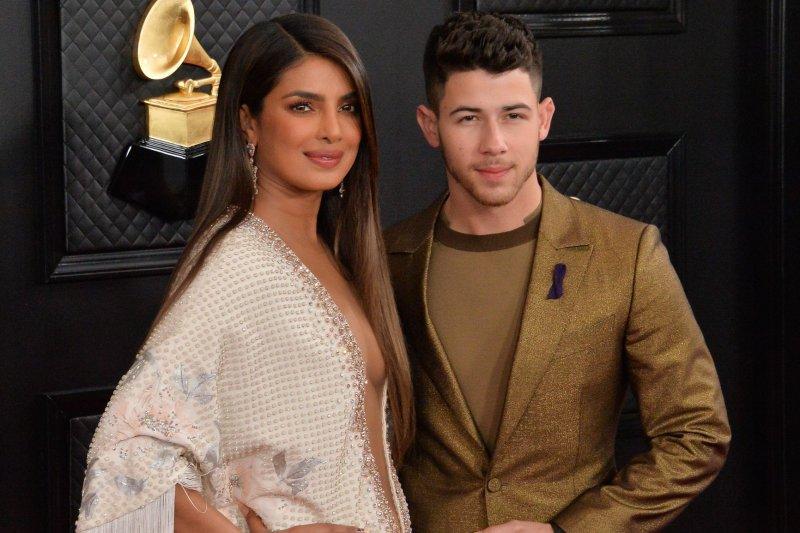 Nick Jonas (R) and his wife, Priyanka Chopra Jonas, arrive for the 62nd annual Grammy Awards in January 2020. Jonas is hosting the 2021 Billboard Music Awards on Sunday. File Photo by Jim Ruymen/UPI
