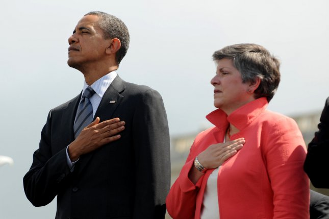 President Barack Obama and Secretary of the Department of Homeland Security Janet Napolitano are shown during the national anthem at a ceremony in Washingon May 15, 2012. UPI/Michael Reynolds/Pool