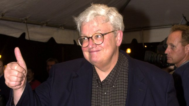 Film critic Roger Ebert gives the thumbs up on his arrival at the gala screening of Training Day at Roy Thomson Hall September 7, 2001 during the Toronto International Film Festival in Toronto, Canada. UPI/Christine Chew