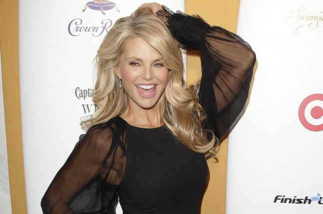 Christie Brinkley arrives on the red carpet at the Sports Illustrated Swimsuit 50 Years of Swim in NYC Celebration at the Sports Illustrated Swimsuit Beach House in New York City on February 18, 2014. Brinkley and John Mellencamp have split after one year of dating. File Photo by John Angelillo/UPI
