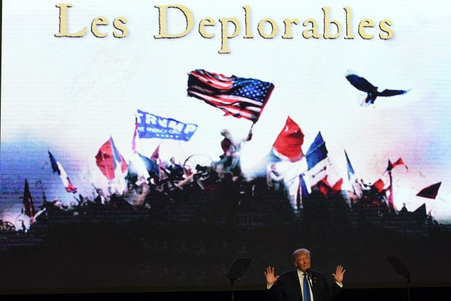 Republican presidential nominee Donald Trump stands before a backdrop invoking the musical Les Miserables referencing Hillary Clinton's remark half of his supporters are deplorables. During the speech in Miami Trump said Clinton's Secret Service detail should disarm to see what happens to her. Photo by Gary I. Rothstein/UPI