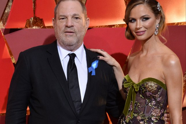 Producer Harvey Weinstein (L) and designer Georgina Chapman arrive on the red carpet for the 89th annual Academy Awards in Los Angeles on February 26. Chapman announced she is leaving Weinstein Tuesday. File Photo by Jim Ruymen/UPI