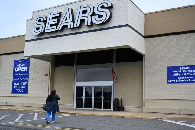 A woman enters a Sears store in Alexandria, Va., on October 15 as the company files for bankruptcy. The company said Tuesday it would ask a judge to allow it to liquidate. File Photo by Pat Benic/UPI