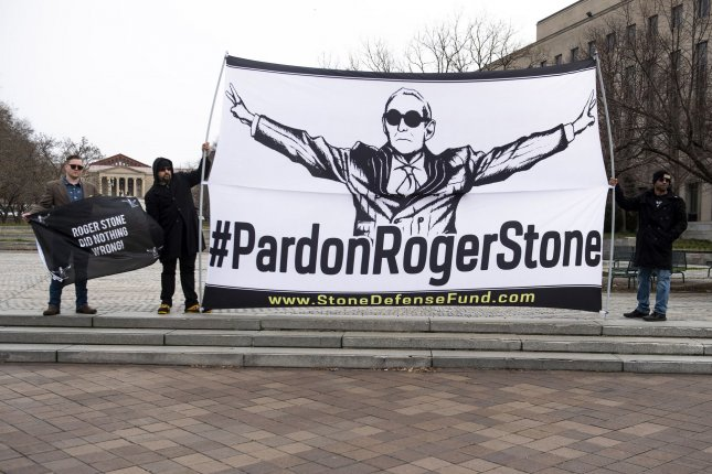 Supporters of Roger Stone stand outside a Washington, D.C., courthouse on February 20 on the day the political strategist was sentenced to 40 months in prison. File Photo by Kevin Dietsch/UPI