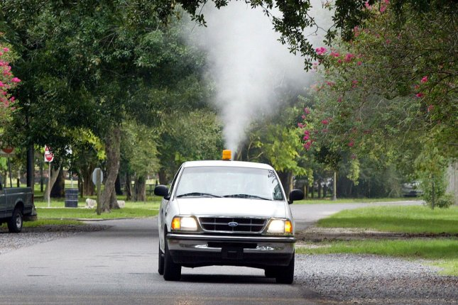 A City of New Orleans Mosquito Control Board truck sprays for mosquitoes in uptown New Orleans in 2002. Photo by A.J. Sisco/UPI