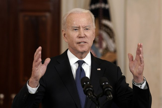 Biden signs order directing government to limit economic risks of climate change