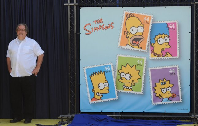 Creator and Executive Producer Matt Groening stands beside a display at the unveiling of the new The Simpsons U.S. postage stamps in Los Angeles May 7, 2009. (UPI Photo/Jim Ruymen)