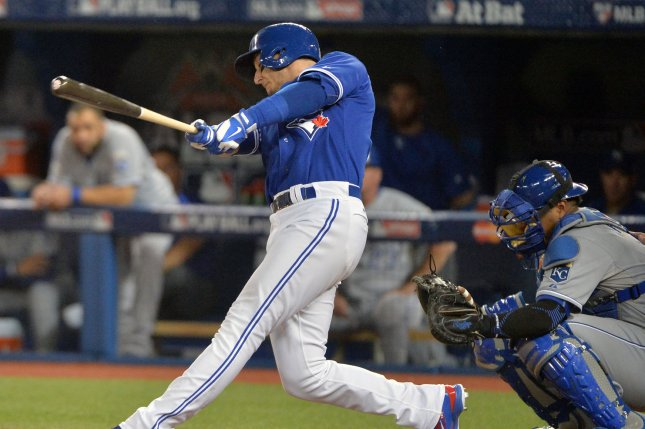 Toronto Blue Jays shortstop Troy Tulowitzki hits a three-run double with the bases loaded against the Kansas City Royals during the sixth inning in the ALCS game 5 at the Rogers Centre in Toronto, Canada on October 21, 2015. Photo by Kevin Dietsch/UPI