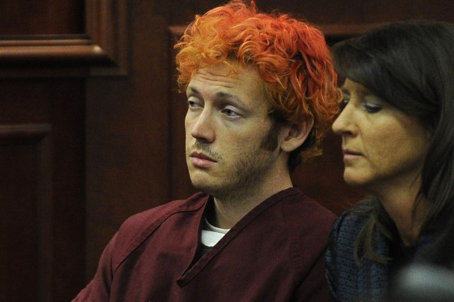 James Holmes, the mental disturbed man convicted to killing 12 people in a shooting rampage at a Colorado movie theater, appeared in court in 2012, shortly after the incident. His mother, Arlene Holmes, has finally broken her silence in support of mental health reserach. File photo by RJ Sangosti/UPI