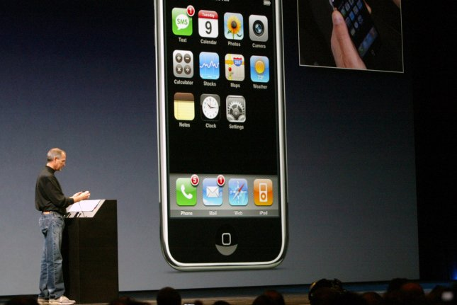 Steve Jobs, CEO of Apple Inc., demonstrates the new iPhone, during the keynote speech at the MacWorld Expo in San Francisco, California, on January 9, 2007. Photo by Aaron Kehoe/UPI