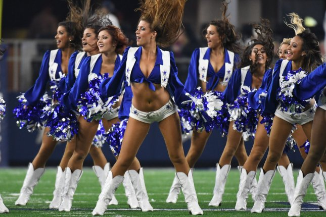 701914589d7 Dallas Cowboys cheerleaders perform during the Cowboys and Detroit Lions  game at AT&T Stadium in Arlington, Texas on December 26, 2016.