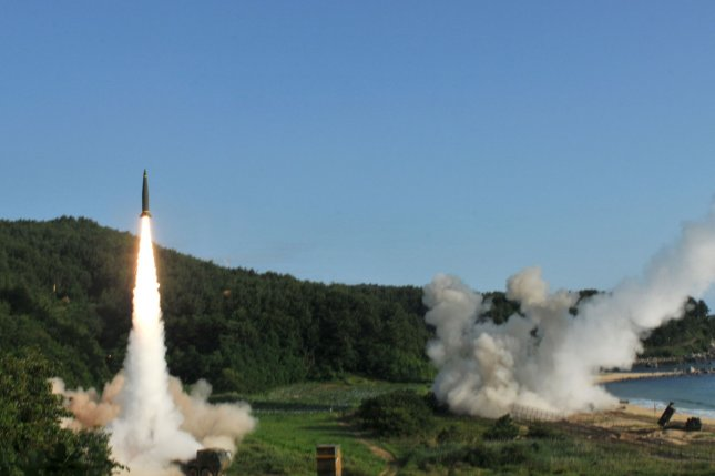 An M270 Multiple Launch Rocket System (R) fires an MGM-140 Army Tactical Missile into the East Sea, on Wednesday, while a Hyunmoo missile is launched on left. South Korea's defense ministry has been cautious in confirming North Korea's claim of a successful ICBM test. Photo by Sgt. Sinthia Rosario/U.S. Army/UPI