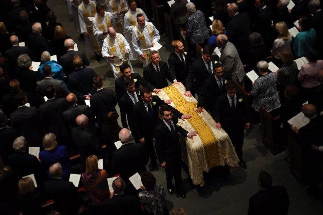 Pallbearers exit following the funeral for former First Lady Barbara Bush at St. Martin's Episcopal Church in Houston, Texas, on Saturday. Pool Photo by Jack Gruber/UPI