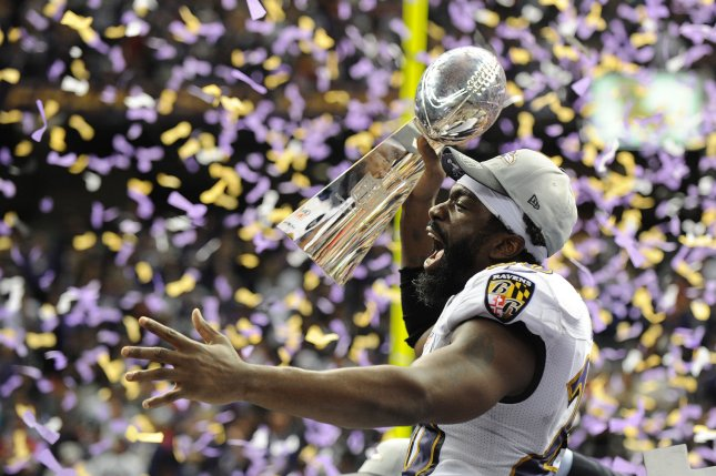 Former Baltimore Ravens safety Ed Reed celebrates with the Lombardi trophy at Super Bowl XLVII at the Mercedes-Benz Superdome on February 3, 2013 in New Orleans. Photo by Kevin Dietsch/UPI