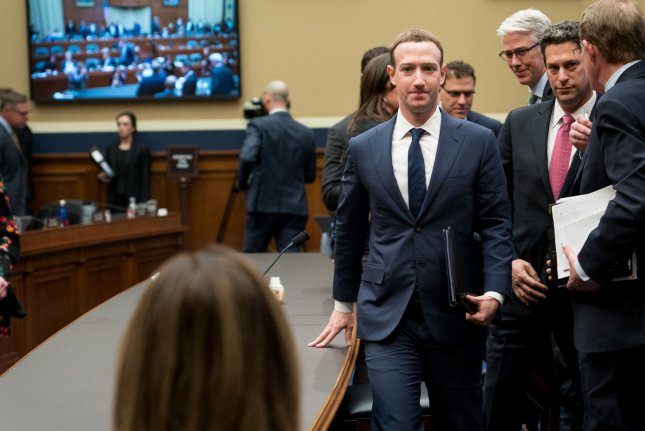 Facebook CEO Mark Zuckerberg, shown here on a break from testifying before the U.S. Congress in April, refused to answer questions about the social media's involvement with Cambridge Analtyica so the British Parliament compelled a third-party app developer to turn over court documents. File Photo by Erin Schaff/UPI