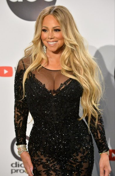 Singer Mariah Carey made a Facetime video call to a California family whose Christmas light display includes a projection of the pop star's Christmas videos. File Photo by Jim Ruymen/UPI