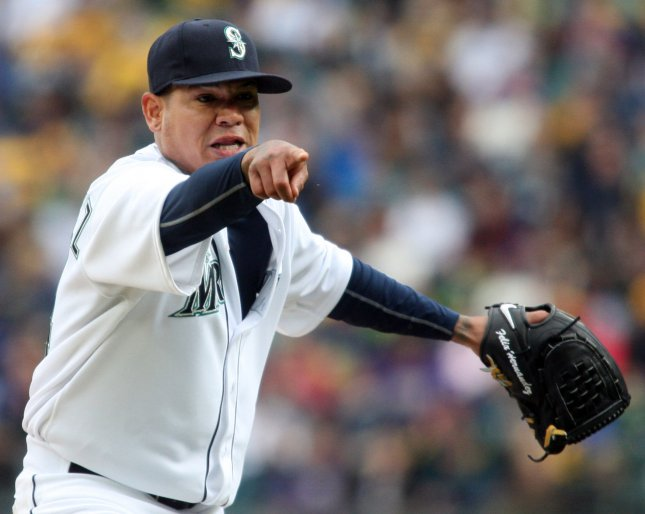 Seattle Mariners' pitcher Felix Hernandez points to home plate after striking out Los Angeles Angels's batter Mike Trout in the sixth inning of the season home opener April 6, 2015 at Safeco Field in Seattle. The Mariners beat the Angels 4-1. Photo by Jim Bryant/UPI