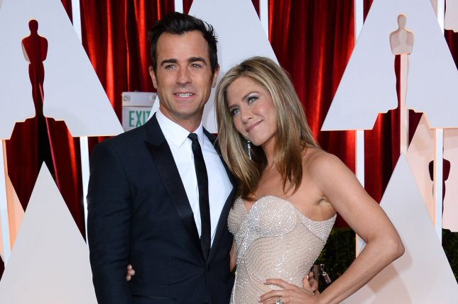 Jennifer Aniston (R) and Justin Theroux at the Academy Awards on February 22, 2015. The couple married in August. File Photo by Jim Ruymen/UPI