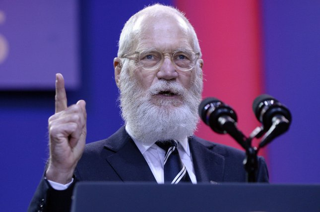 David Letterman speaks on stage at the kickoff of the 5th anniversary of Joining Forces and the 75th anniversary of the USO at Joint Base Andrews on May 5, 2016 in Maryland. The former talk-show host will induct Pearl Jam into the Rock & Roll Hall of Fame Friday. Pool photo by Olivier Douliery/UPI