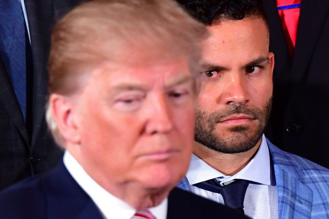 c05141c00 Houston Astros  second baseman Jose Altuve look on as President Donald Trump  stands in front of him during a ceremony where Trump welcomed the 2017  World ...