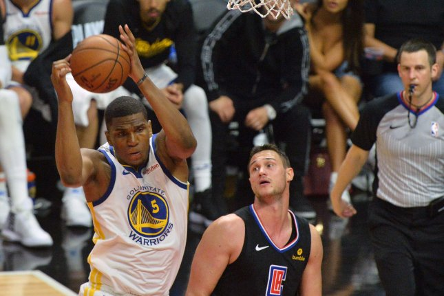 2407a2c1cc1 Golden State Warriors  forward Kevon Looney (5) grabs the offensive rebound  away from Los Angeles Clippers  Danilo Gallinari (8) in the first half of  Game 6 ...