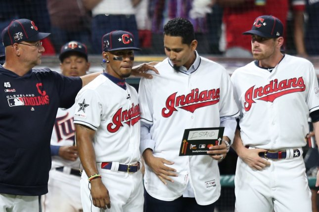 Cleveland Indians pitcher Carlos Carrasco (C) was diagnosed with a treatable form of leukemia in May and returned to the mound in September. Photo by Aaron Josefczyk/UPI