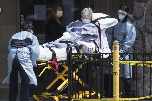 A patient is moved out of Gateway Care and Rehabilitation Center, a skilled nursing facility in Hayward, Calif., in April. Photo by Terry Schmitt/UPI