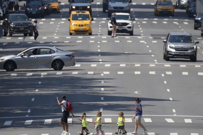 School children cross 10th Avenue on Monday, June 7, 2021 in New York City. Photo by John Angelillo/UPI