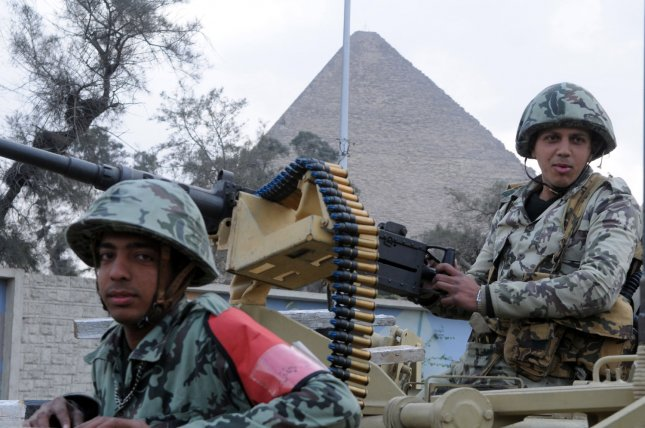 Egyptian army soldiers take position in front of the Giza pyramids in Egypt, on February 9, 2011, the 16th day of consecutive protests calling for the ouster of President Hosni Mubarak. UPI