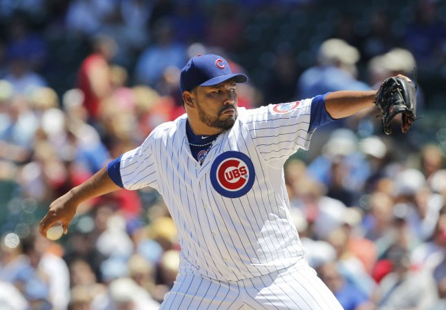 The Chicago Cubs' Carlos Silva delivers a pitch against the Cincinnati Reds July 1, 2010. UPI/Brian Kersey
