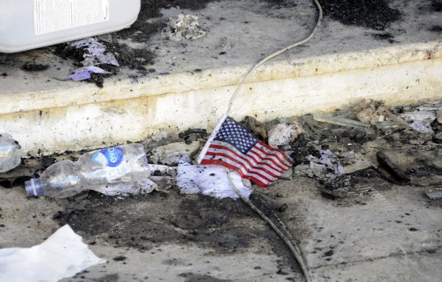 A small American flag is seen in the rubble at the United States consulate, one day after armed men stormed the compound and killed the U.S. Ambassador Christopher Stevens and three others in Benghazi, Libya on September 12, 2012. The gunman were protesting a little known film by an American amateur filmmaker that angered Muslims as it was deemed insulting to the Prophet Mohammad. UPI/Tariq AL-hun