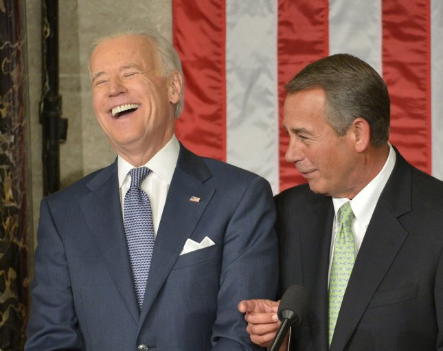 Vice President Joe Biden (L) laughs while speaking with Speaker of the House John Boehner before President Barack Obama makes his State of the Union address to a joint session of congress and the American people in the House Chamber at the U.S. Capitol on January 28, 2014 in Washington, DC. UPI/Kevin Dietsch