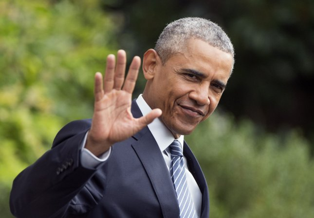 President Obama waves to the media as he departs the White House for a trip to Alaska, in Washington, D.C. on August 31, 2015. Photo by Kevin Dietsch/UPI