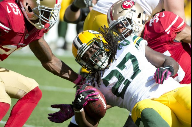 Green Bay Packers Eddie Lacy (27) plows ahead for 10 yards on a fourth and one in the second quarter against the San Francisco 49ers at Levi's Stadium in Santa Clara, California on October 4, 2015. The Packers defeated the 49ers 17-3. Photo by Terry Schmitt/UPI