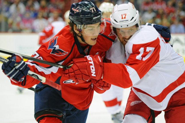 Washington Capitals right wing T.J. Oshie (77) fights for a puck against Detroit Red Wings center Brad Richards (17) in the first period at the Verizon Center in Washington, D.C. on December 8, 2015. Photo by Mark Goldman/UPI