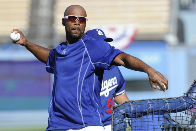 Former Los Angeles Dodgers IF Jimmy Rollins throws pitches during batting practice in the heatwave before game 2 of the National League Division Series against the New York Mets at Dodger Stadium in Los Angeles on October 9, 2015. UPI/Lori Shepler