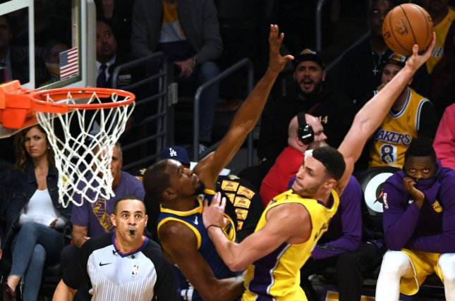 Los Angeles Lakers forward Larry Nance Jr. prepares to dunk on Golden State Warriors forward Kevin Durant Monday at Staples Center in Los Angeles. Photo by Jon SooHoo/UPI