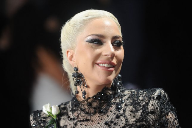 Lady Gaga arrives at the 60th annual Grammy Awards ceremony in New York City on January 28. The singer's fibromyalgia has forced her to cancel 10 dates on her world concert tour. Photo by Dennis Van Tine/UPI