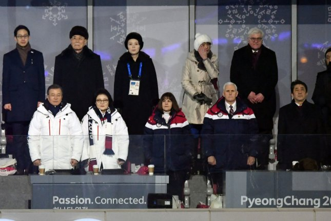 U.S. Vice President Mike Pence (R) and Japanese Prime Minister Shinzo Abe stand in front of Kim Yo Jong, North Korean leader Kim Jong Un's younger sister during the opening ceremony at the Pyeongchang 2018 Winter Olympics. Photo by Richard Ellis/UPI