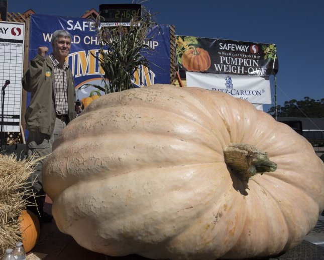 Steve Daletas of Pleasant Hill, Oregon pumps his fist as his pumpkin wins the 45th annual Half Moon Bay Pumpkin Weigh-Off in Half Moon Bay, Calif., on Oct. 8, 2018. The 2,170 pound behemoth won the competition. Photo by Terry Schmitt/UPI
