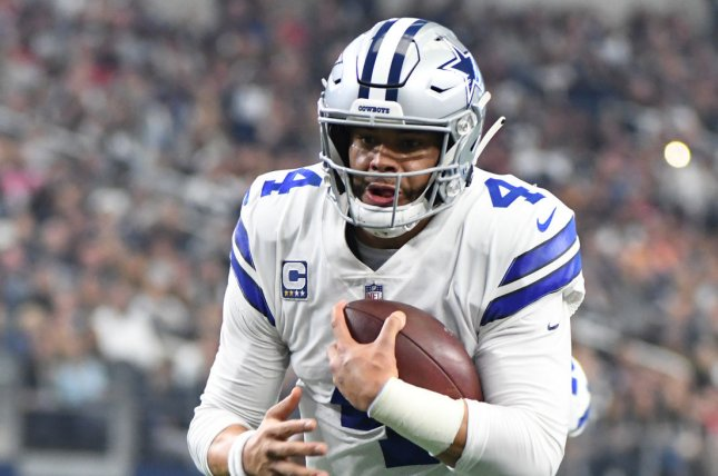 Dallas Cowboys quarterback Dak Prescott scores on a 7-yard run against the Tampa Bay Buccaneers in the first quarter on Sunday at AT&T Stadium in Arlington, Texas. Photo by Ian Halperin/UPI