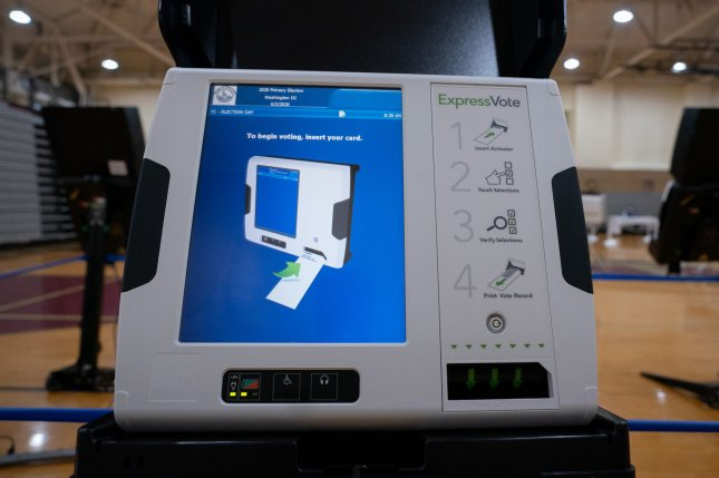 An electronic voting machine is seen during Tuesday's primary election in Washington, D.C. Friday's report says securing November's election will be costly due to coronavirus-related revenue cuts. Photo by Kevin Dietsch/UPI
