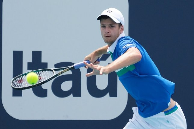 Hubert Hurkacz (pictured) hits a forehand return against Jannik Sinner at the Miami Open on Sunday in Miami Gardens, Fla. Photo by Gary I Rothstein/UPI