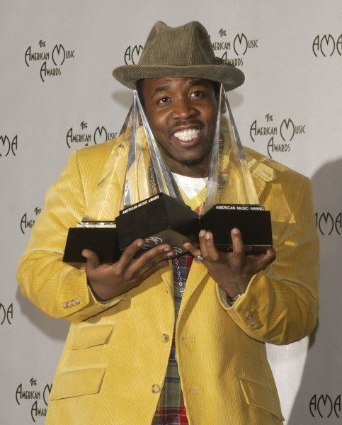 Big Boi of the group Outkast poses backstage with the three awards the group garnered at the 32nd annual American Music Awards in Los Angeles November 14, 2004. They won for Rap/Hip-Hop Favorite Album, Favorite Group Pop/Rock and Rap/Hip-Hop..(UPI Photo/Jim Ruymen)